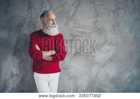 Photo Of Attractive Aged Guy Holding Hands Crossed Looking Empty Space Minded Wear Red Knitted Pullo