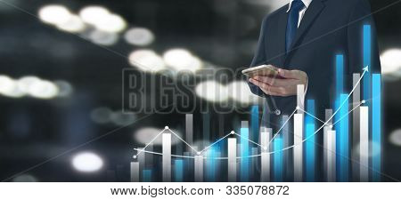 Businessman Plan Graph Growth And Increase Of Chart Business.smartphone In Hand