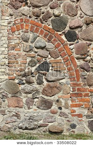 Bricked-up Pointed Arch Portal Of A Medieval Village Church