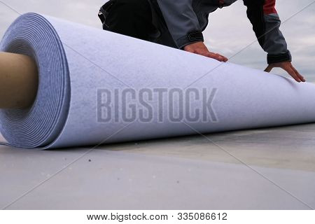 Rolls Of Polymer Coating For The Roof. Deployment Of A Roof Covering Roll.