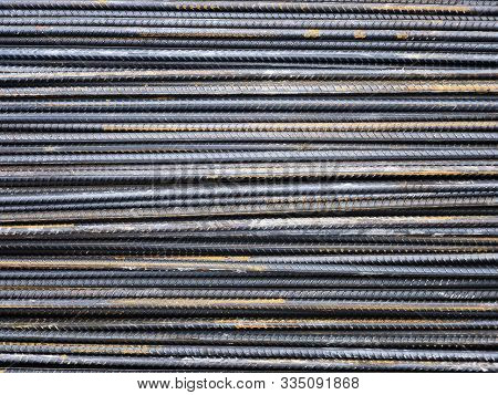 Steel reinforcement rebars tied with metal wire at the outdoor warehouse poster