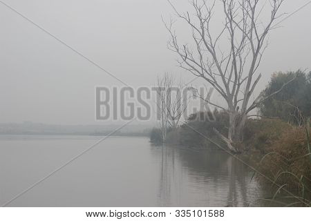A Calm And Serene November Morning Over The Pond, A Misty Rural Landscape Of Autumn At Dawn, The Sky