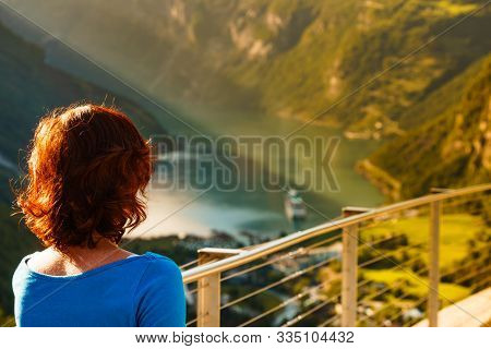 Tourist Woman Enjoying Scenic View Over Fjord Geirangerfjord From Flydalsjuvet Viewpoint. Cruising V