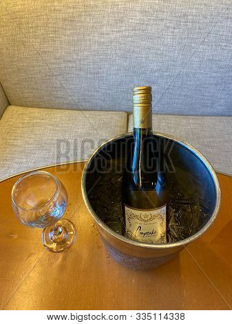 Ft. Lauderdale, Fl/usa-10/30/19: A Wine Glass And Ice Cold Bucket Of Cupcake Chardonnay Wine Ready T