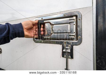 Man Hand Opening A Truck Freezer Door