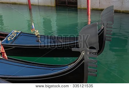 Noses (ferro) Gondolas On A Pier On A Canal In Venice