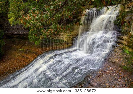 Michigan Clean Water Background. Pristine Clear Water Of Laughing Whitefish Falls In The Upper Penin