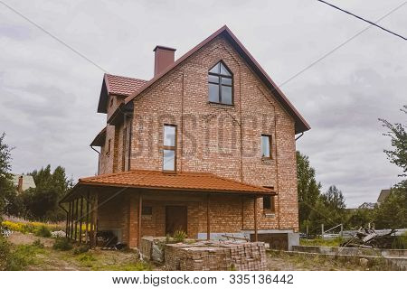 Modern Roof Made Of Metal. Corrugated Metal Roof And Metal Roofing. Beautiful Pink Brick Brick House