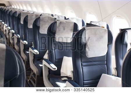 Empty Economy Class Seats In The Cabin Of The Aircraft, Close-up