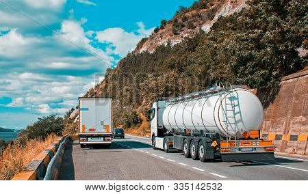 A Large White Truck Carrying Flammable Substances. A Big Fuel Tanker Truck. Romania, Severin. August