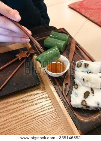 Eating Sweet Tteok (korean Rice Cake) In Local Teahouse In Seoul City, South Korea (snapshot By Mobi