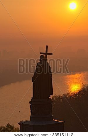 Silhouette Of The Monument Of Saint Vladimir (volodymyr The Great) During Sunrise. Morning Thick Fog
