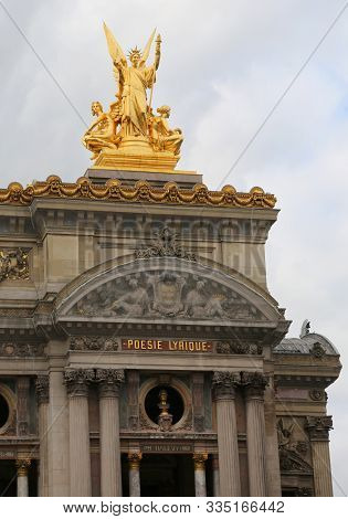 Paris, France - August 20, 2018:  Opera And Famous Palace Called Palais Garnier With Golden Statue A