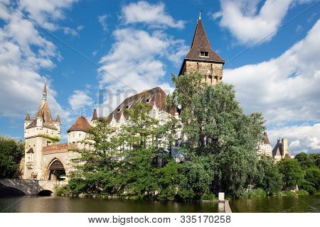Budapest Vajdahunyad Castle Viewed From Its Lakeside And Sky With Beautiful Clouds