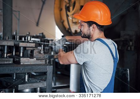 Experienced Operator In A Hard Hat. Metalworking Industry Concept Professional Engineer Metalworker