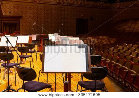 Music Books And Sheets With Musical Notation On The Stands Ready To The Concert. Equipment Of The Or