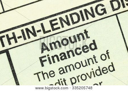 Photograph of amount financed macro detail of the standard federal truth in lending section on an automobile purchase loan form.