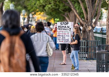 November 07, 2019 - Las Vegas, Nevada, USA: Young protestors show their support for stopping human trafficking in front of the Bellagio Hotel and Resort in Las Vegas, Nevada.