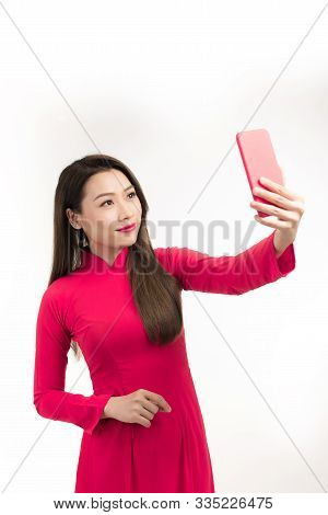 Woman In Ao Dai Taking Selfie By Mobile Phone In Vietnamese Tet Holiday