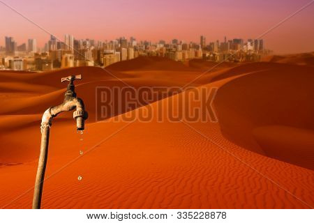 Dripping Tap, Desert And Skyline Of Big City In The Background, Concept Of Global Warming Planet, Wa