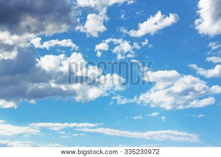 Blue Sky With Clouds On A Sunny April Day. Dynamic Formations In Windy Weather