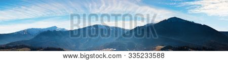 Panorama Of Mountains With Snow Capped Tops Above The Rural Valley. Wonderful Weather Condition Of N