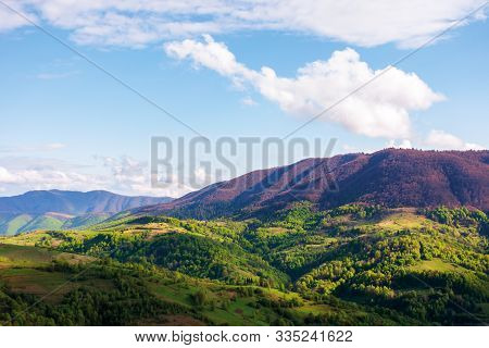 Beautiful Mountainous Landscape In Springtime. Wonderful Afternoon Sunny Weather With Clouds On The