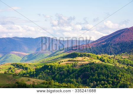 Beautiful Mountainous Countryside In Springtime. Wonderful Afternoon Sunny Weather With Clouds On Th