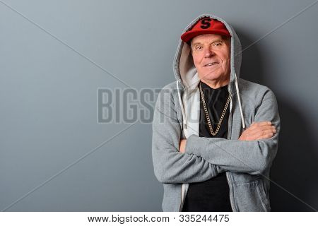 Dad Dressed In Teenager Clothes: A Light Gray Hoodie Over A Black T-shirt