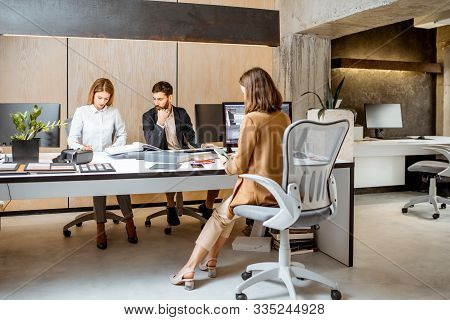 Creative Office Employees Making Interior Design On The Computers, Sitting At The Modern Office Of A