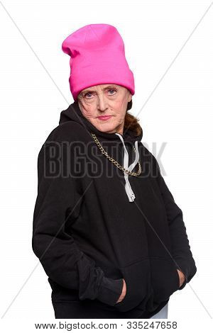 Sad Granny In Modern Clothes Holding Her Hands In Pockets Of Hoodie