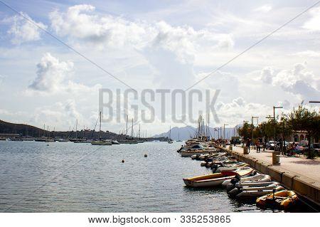 Port De Pollenca, Mallorca, Spain, 09-19-2018: View Of Port. Cloudy Sky, Beautiful Landscape In Back