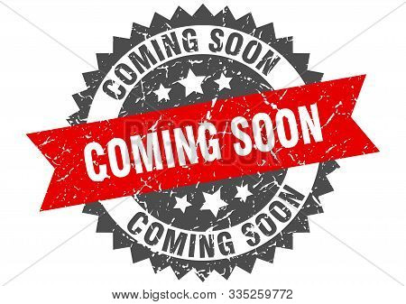 Coming Soon Grunge Stamp With Red Band. Coming Soon