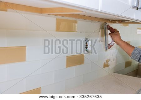 Tilers Filling The Space Tiles Using Rubber Trowel Grouting Ceramic Tiles.