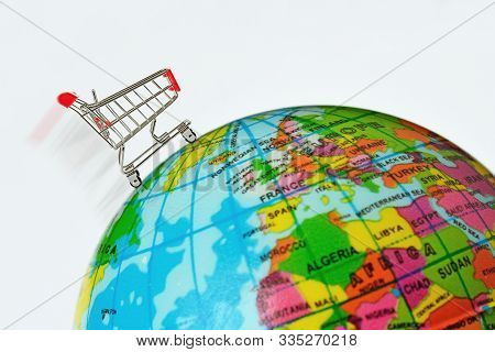 Shopping Cart Over Eath Globe - Concept Of Shopping And Global Market