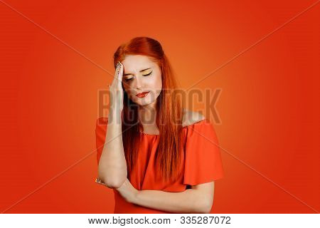 Young Redhead Sad Upset Stressed Woman Having Headache Feeling Pain, Touching Head Wearing Red Dress