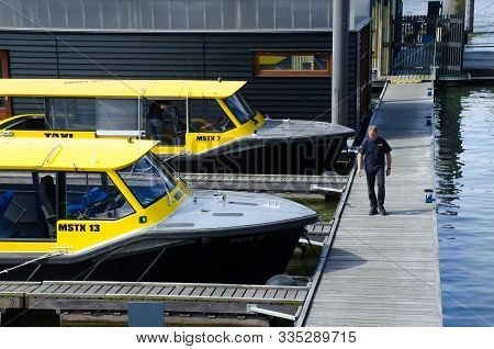 Rotterdam/netherlands May 12th 2018 - Water Taxi Docked In The Dockyard In Rotterdam