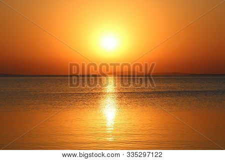 Dawn Above Sea. Beautiful Summer Daybreak Above Ocean. Beautiful Blazing Dawn Landscape Above Red Se