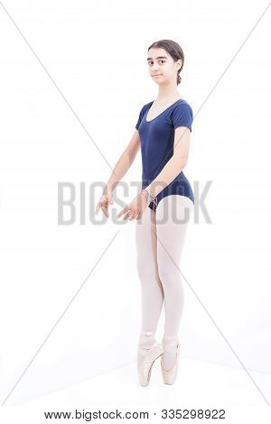 A Ballet Dancer On Tiptoe On White Background