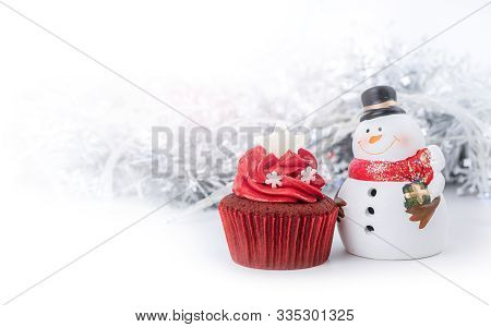 Merry Christmas And Happy New Year With Red Cupcake And Snowman Statuette And Snowflake Ribbon Backg
