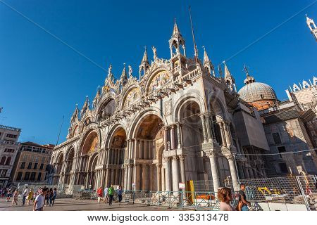 Venice, Italy - 15.08.2018: Piazza San Marco With The Basilica Of Saint Mark And The Bell Tower Of S