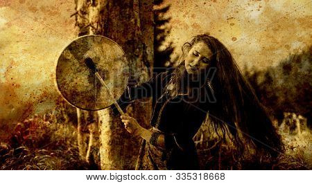 Beautiful Shamanic Girl Playing On Shaman Frame Drum In The Nature, Old Efect.