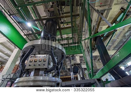The Extruder Produces Black Plastic Garbage Bags. Factory For Recycling Used Stretch Film And Plasti