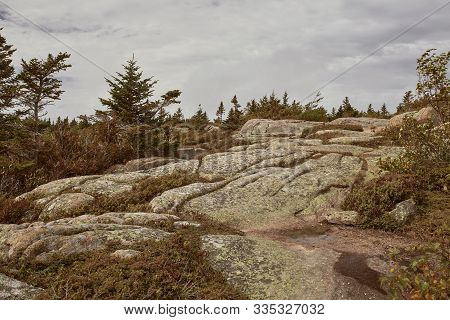 Hiking Along Granite Bedrock On The Summit Of Cadillac Mountain In Acadia National Park On Mount Des