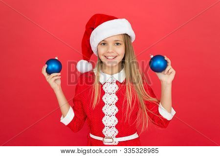 Christmas Ball Decor. Christmas Decorating Ideas For Kids Room. Child Red Costume Hold Christmas Orn