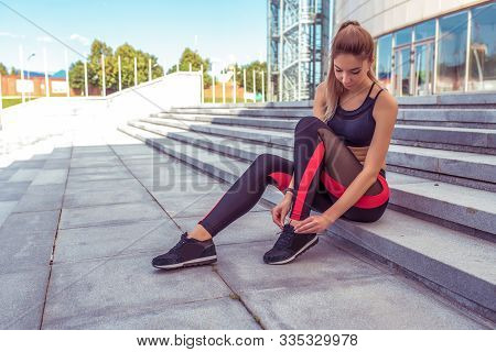 Beautiful Athletic Woman Resting After Workout Tying Shoelaces Sneakers, Jogging Morning, Stairs Bac