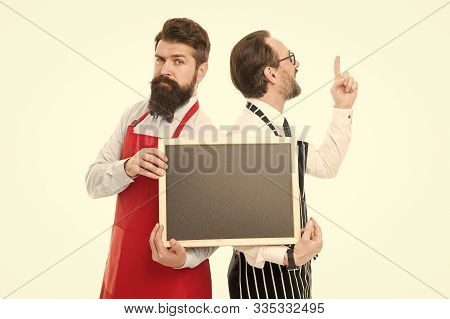 Men Bearded Bartender In Apron Hold Blank Chalkboard. Bartender With Blackboard Advertisement. Hipst