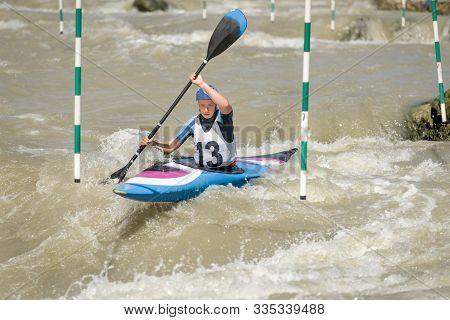 White Water Kayak Athlete Racing Through A Downstream Slalom Gate