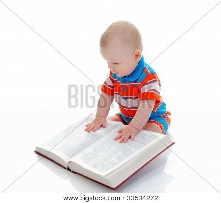 Little smart boy reads a big book. Isolated on white background poster