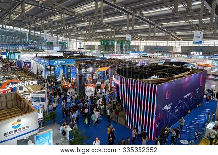 SHENZHEN, CHINA - CIRCA NOVEMBER, 2019: top view of exhibition stands and people at China Hi-Tech Fair 2019 at Shenzhen Convention & Exhibition Center.